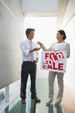 Estate agent giving keys to new home owner Royalty Free Stock Image