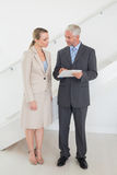 Estate agent going over contracts with customer Stock Image