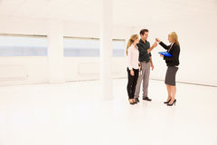 Estate Agent Handing Over Keys To Office Space� Stock Image