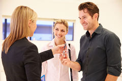 Estate Agent Handing Over Keys To Office Space� royalty free stock photos