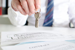 Estate agent holding house keys Stock Image