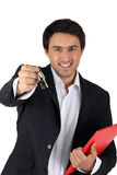 Estate-agent holding keys Stock Photo