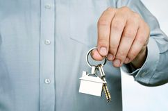 Estate agent holding keys to new house Royalty Free Stock Image