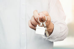Estate agent holding keys to new house Royalty Free Stock Photo