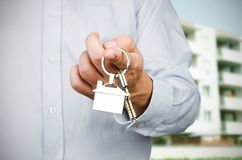 Estate agent holding keys to new house Stock Photography