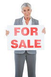 Estate agent holding for sale sign. On white background Stock Photos