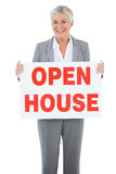 Estate agent holding sign for open house Royalty Free Stock Photos