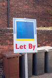 Estate agent. Let by sign in a suburb of London Royalty Free Stock Photos