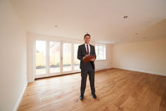 Estate Agent Looking Around Vacant New Property Royalty Free Stock Photo