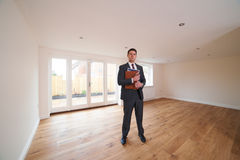 Estate Agent Looking Around Vacant New Property Stock Photos