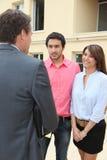 Estate agent meeting couple stock photo