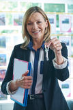 Estate Agent In Office Holding Keys To Property Royalty Free Stock Photography