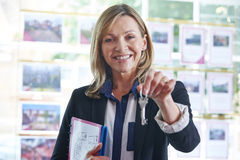 Estate Agent In Office Holding Keys To Property Royalty Free Stock Photo