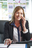 Estate Agent On Phone In Office Stock Photo