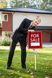 Estate agent preparing house for sale Stock Photography