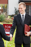 Estate agent shaking hand of client Stock Photography