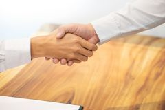 Estate agent shaking hands with customer after contract signature as successful agreement in real estate agency office. Concept o stock photos