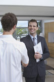 Estate Agent Shaking Hands With Customer Indoors Stock Photography