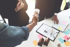Estate agent shaking hands with his customer after contract sign royalty free stock photos
