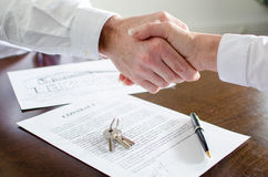 Estate agent shaking hands with his customer Stock Images