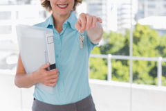 Estate agent showing house keys Royalty Free Stock Image
