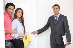 Estate-agent showing off property Stock Photos