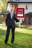 Estate agent standing in front of house Royalty Free Stock Photography
