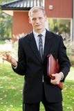 Estate agent standing outside the house Stock Photos