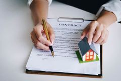 Estate agent use the pen pointing on document showing where to s royalty free stock photo