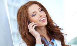 Estate agent woman on the phone Royalty Free Stock Photo