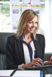 Estate Agent Working At Desk In Office Royalty Free Stock Photos