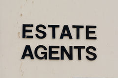 Estate Agents sign on wall of building Royalty Free Stock Image