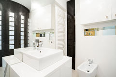 Estate bathroom. Photo of white marble estate bathroom Stock Images