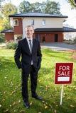 Estate broker standing outside the house Stock Image