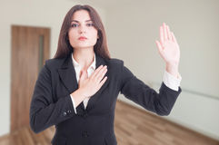Estate broker swearing or telling the truth Stock Photo