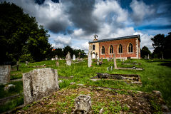 Estate church with graves stones Royalty Free Stock Photos