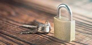 Free Estate Concept With Symbol Of Security, Lock Padlock With Key On Old Wooden Background. Stock Images - 113323194