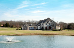 Estate home with lake and fountain 55 stock photo