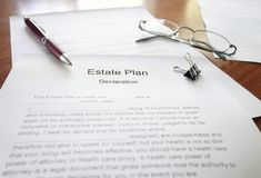 Estate Plan document. An Estate Plan document on a desk with pen and glasses Royalty Free Stock Images