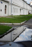 The Estate Of The Romanovs In Izmailovo recreation park and manor, Moscow, Russia. Color photo, no people. Green trees and puddle reflection Royalty Free Stock Photo