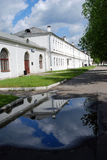 The Estate Of The Romanovs In Izmailovo recreation park and manor, Moscow, Russia. Color photo, no people. Green trees and puddle reflection Royalty Free Stock Photography