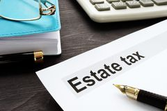 Estate tax and gavel on the wooden desk royalty free stock photos