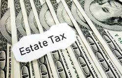 Estate Tax news. Headline  on hundred dollar bills Royalty Free Stock Image