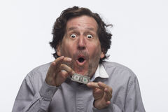 Estatic man holding dollar bill, horizontal Royalty Free Stock Photos