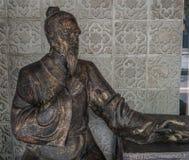 Estatua china del viejo hombre imagenes de archivo