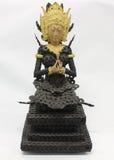 Estatua de Bali hecha de monedas antiguas Imagen de archivo libre de regalías