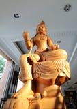 Estatua de Buda, del monje y del animal sagrado Imagen de archivo libre de regalías