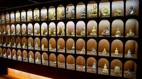 Estatua de Buda, del monje y del animal sagrado Imagenes de archivo