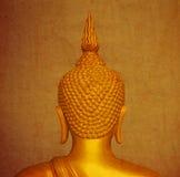 Estatua de Buda en el papel viejo imagenes de archivo