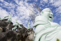 Estatua de Buda que se sienta y sonriente Imagen de archivo